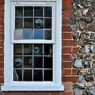 Window and flint wall by richard  webb