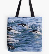 Gentoo penguins (Pygoscelis papua). swimming in the ocean Tote Bag