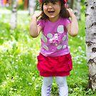 Little girl in park by Ivo Velinov