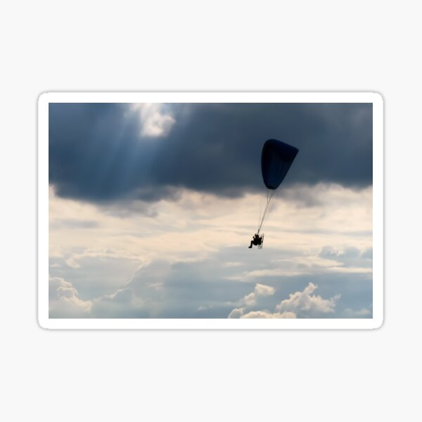 Powered Paraglider Flying in the Stormy Clouds Sticker
