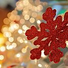 Red snowflake and Christmas lights  by Svetlana Day