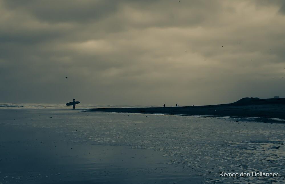 Surfer on Winter Beach by Remco den Hollander
