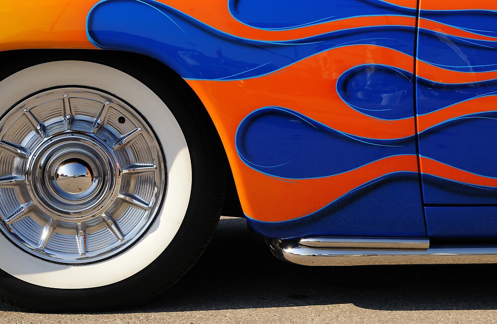 Chrome hubcap and orange flames by woodnimages