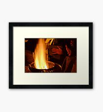 Hands Warming by the Fire Framed Print
