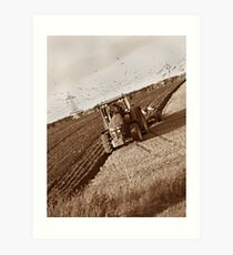 Ploughing tractor Art Print
