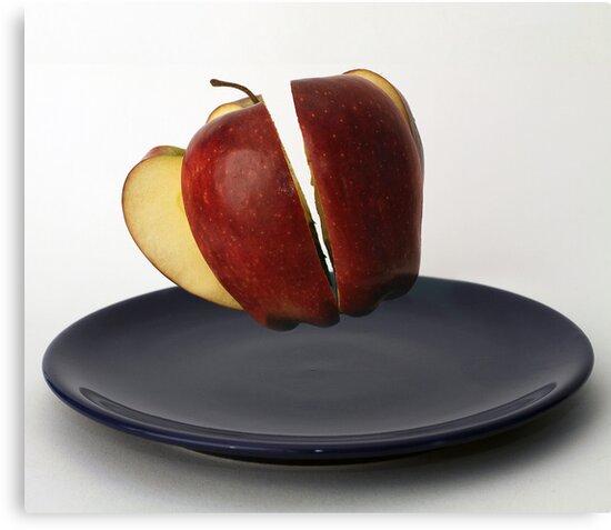 Flying sliced apple by vegard7