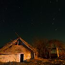 Mud hut by night by Gabor Pozsgai