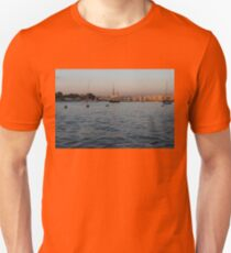 Sunrise Glow at Malta's Marsamxett Harbour T-Shirt