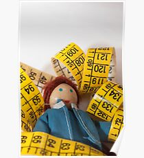Doll resting on measuring tape Poster