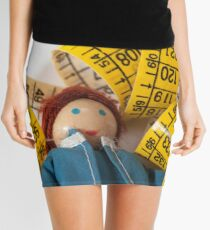Doll resting on measuring tape Mini Skirt