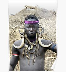 A Mursi tribesman warrior with warthog fangs earring decoration Poster
