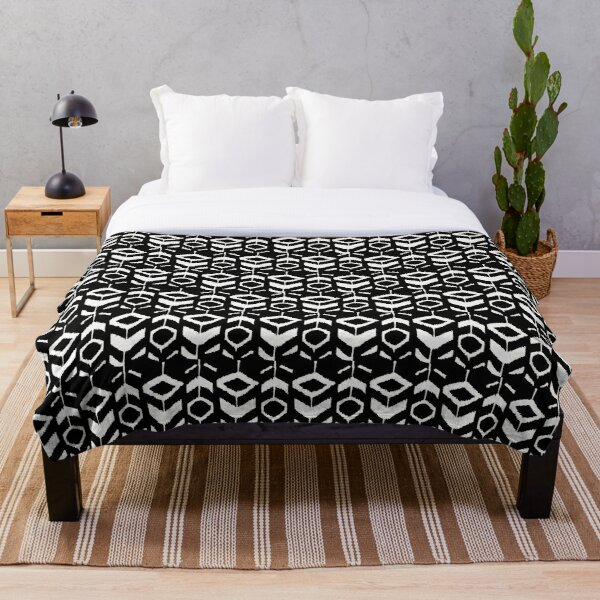 White flower pattern on a black background Throw Blanket