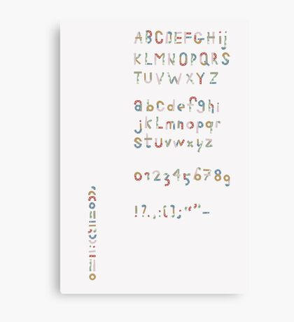 Alphabet in pieces of pattern paper Canvas Print