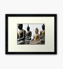 Light Stone Buddha focus and Three Dark out Framed Print
