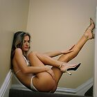 Beautiful girl in bikini looking at her legs in stiletto shoes 2 by Anton Oparin