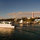 Ferry Boat and Lighthouse, Hope Town, Abaco, Bahamas by Shane Pinder