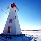 Lighthouse in Winter in Charlottetown Prince Edward Island by Nadine Staaf