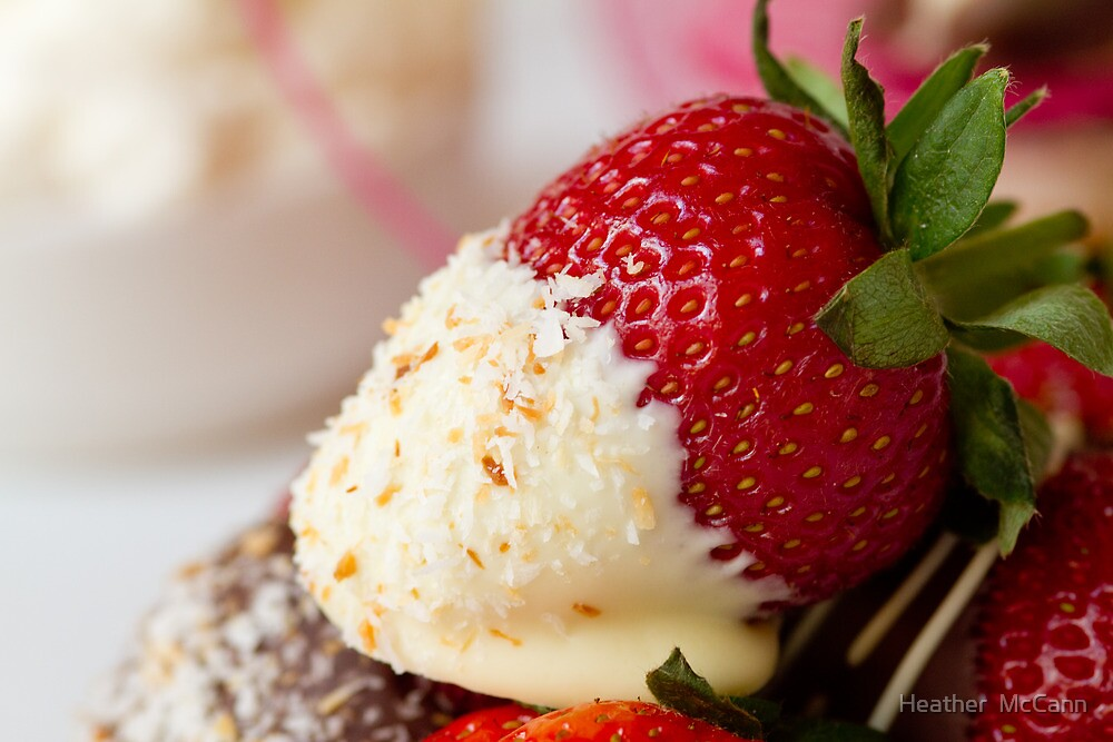 Single chocolate dipped strawberry coated with coconut by Heather  McCann