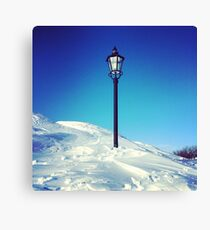 Old Lamp Post in Snow with Blue Sky Canvas Print