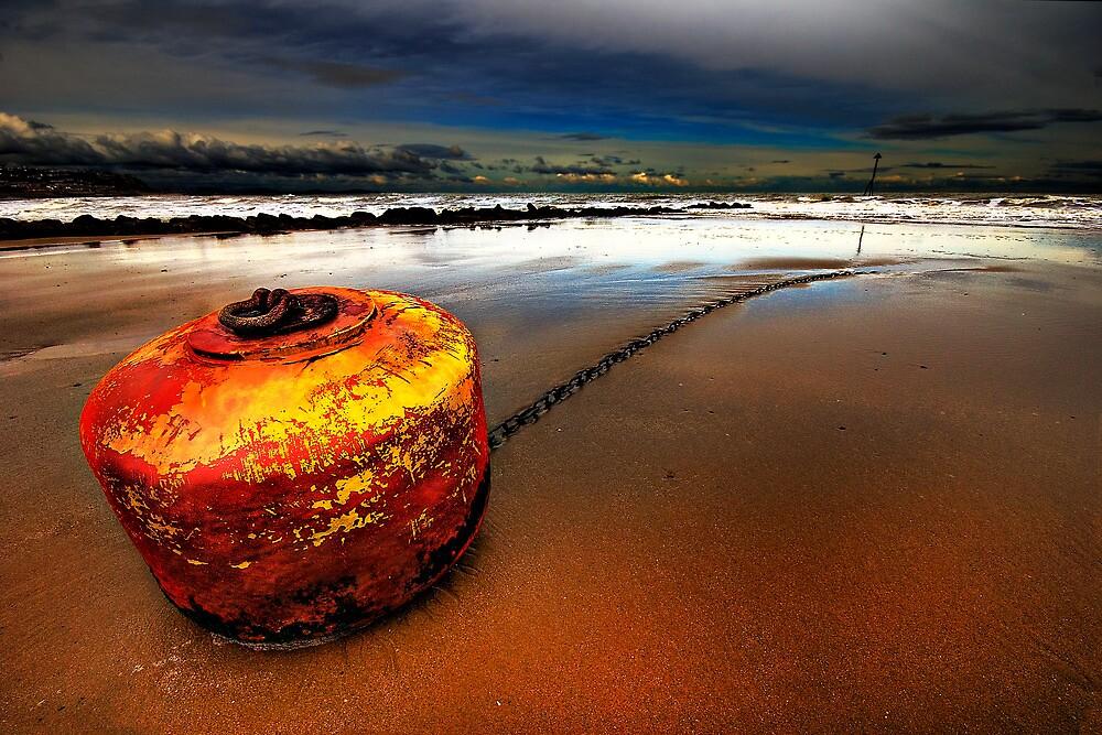 stranded stormy ornage buoy by meirionmatthias