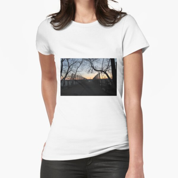 Sunset, also known as sundown, is the daily disappearance of the Sun below the horizon due to Earth's rotation Fitted T-Shirt