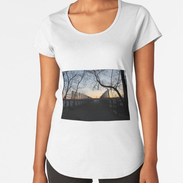 Sunset, also known as sundown, is the daily disappearance of the Sun below the horizon due to Earth's rotation Premium Scoop T-Shirt