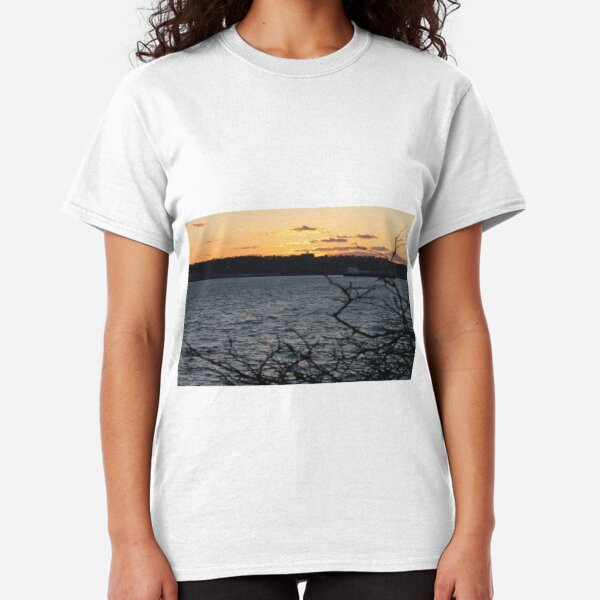 Sunset, also known as sundown, is the daily disappearance of the Sun below the horizon due to Earth's rotation Classic T-Shirt