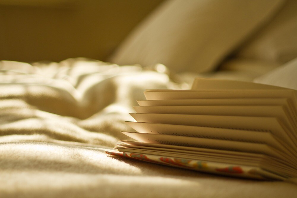 Reading in bed by Justine Gordon