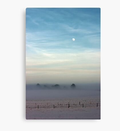 Snow, mist and moon Canvas Print