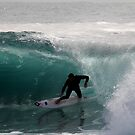 Surfer getting Barrelled at Dee Why Point by Andrew  MCKENZIE