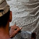 Stone carver at work in Batubulan, Bali, Indonesia. by Michael Brewer