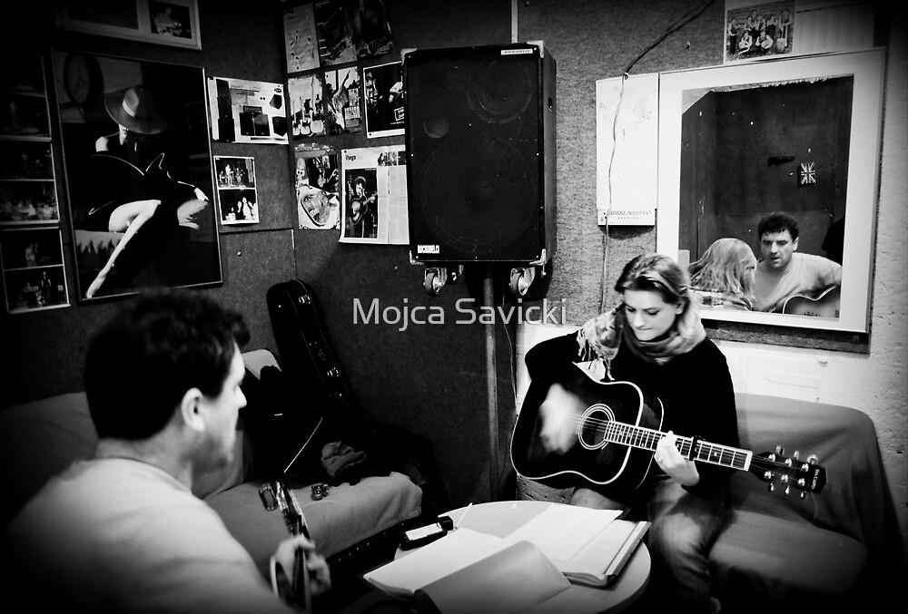 Two guitars by Mojca Savicki