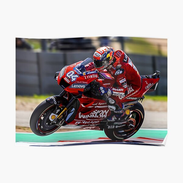 Andrea Dovizioso accelerating hard and making a wheelie Poster