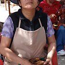 Woman polishing carved artcraft - Mujer ligando Artesanía esculpada by PtoVallartaMex