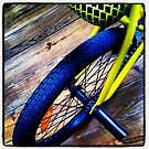 Yellow bycicle I by Mario Brandao