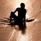 Man silhouetted at sunset at Seminyak Beach, Bali, Indonesia by Michael Brewer