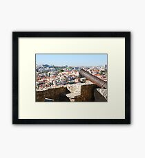 Lisbon cityscape over cannon Framed Print