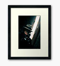 Gunman Framed Print