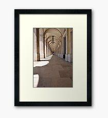 Commerce square arcades in Lisbon Framed Print