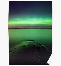 Northern lights glow over lake Poster
