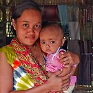 The sarong saleswoman and her baby by Adri  Padmos