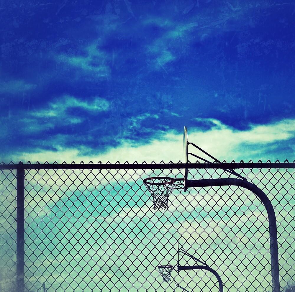 Basketball hoops inside fence at Wells Middle School, Dublin California by Dan Fitzpatrick