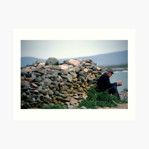 Donegal man contemplating by dry-stone wall close to beach Art Print