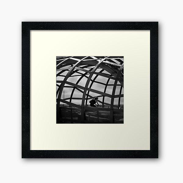 Caged Peddler Framed Art Print