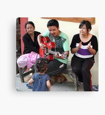 A musician entertaining his family. Canvas Print