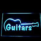 Guitars in Blue Neon by Jane Neill-Hancock