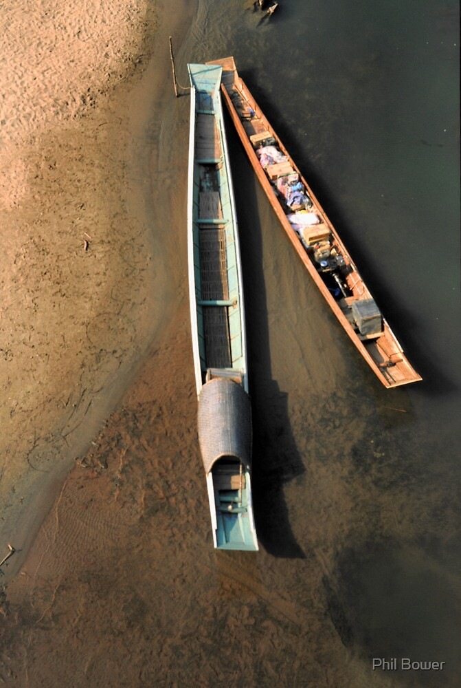 Long boats floating on the Nam Ou river, North Laos. by Phil Bower