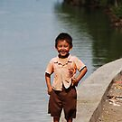 Boy down by the river in West Bali by Michael Brewer