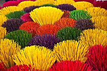 Buckets of incense sticks by Janette Anderson