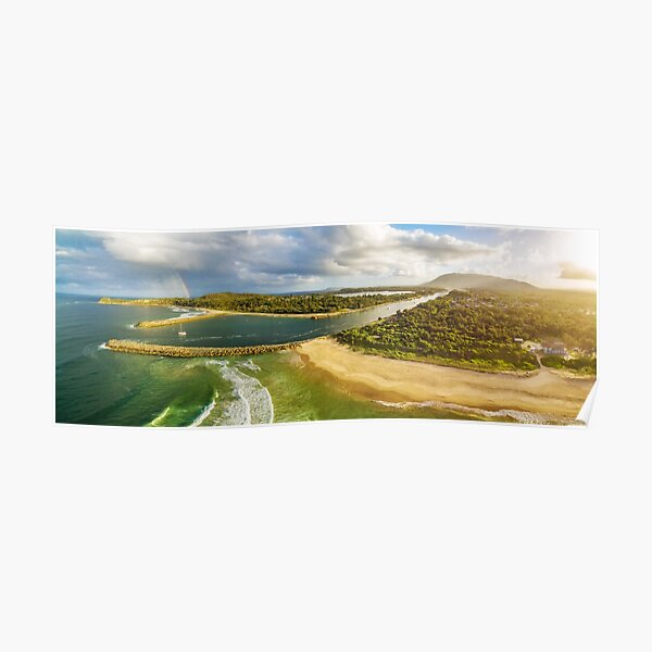 Scenic aerial panorama of ocean coastline, rainbow, and boat at sunset Poster